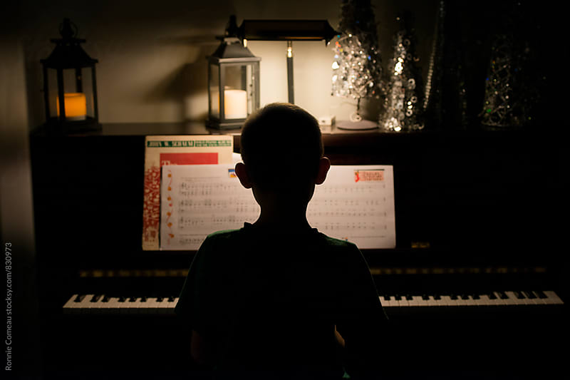 Boy Practicing Piano by Ronnie Comeau for Stocksy United
