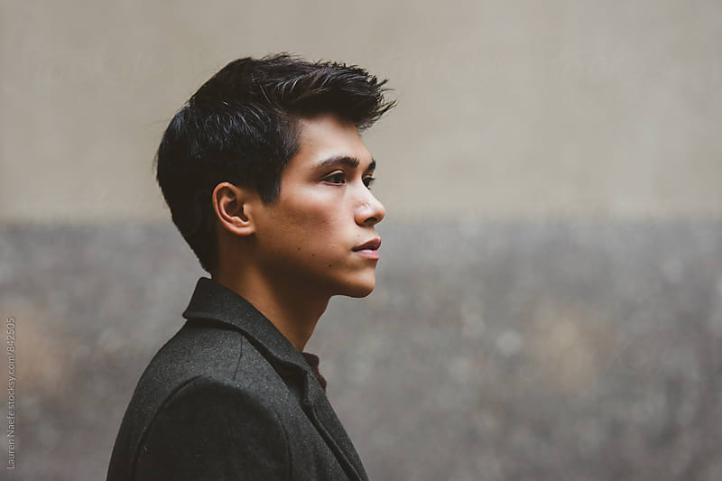 Young man in profile by Lauren Naefe for Stocksy United