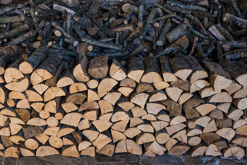 a pile of chopped wood by Juri Pozzi for Stocksy United