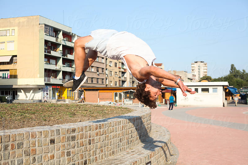 Man jumping in the city by Marija Mandic for Stocksy United