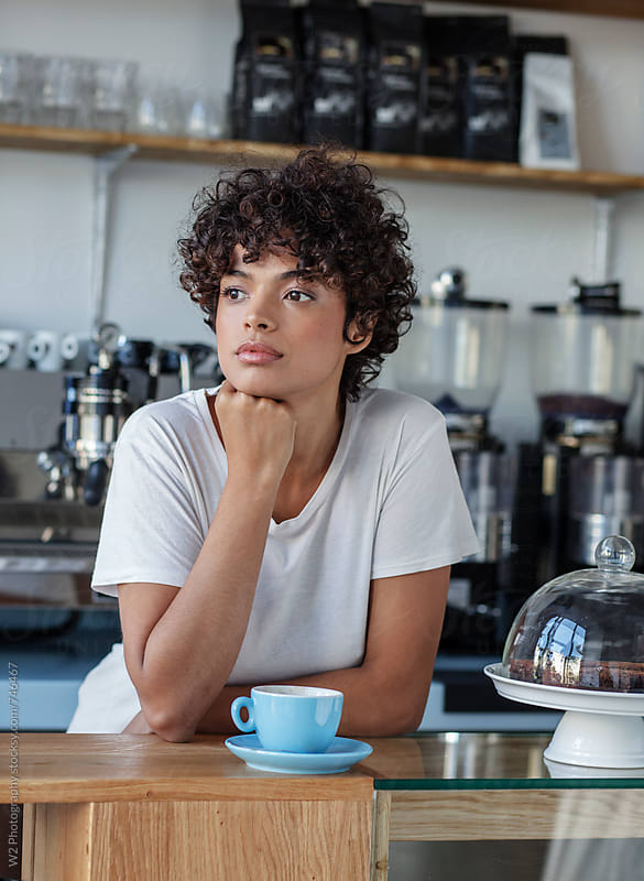 Portrait of beautiful young woman in a cafe by W2 Photography for Stocksy United