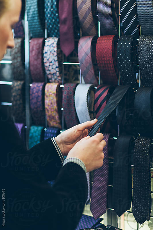 Man shopping for ties. by kkgas for Stocksy United