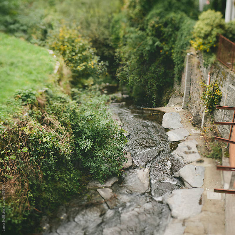 Above sight of brook streaming amongst houses in a mountain italian village by Laura Stolfi for Stocksy United