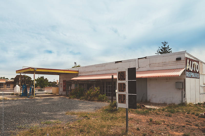 abandoned fuel station  by Gillian Vann for Stocksy United