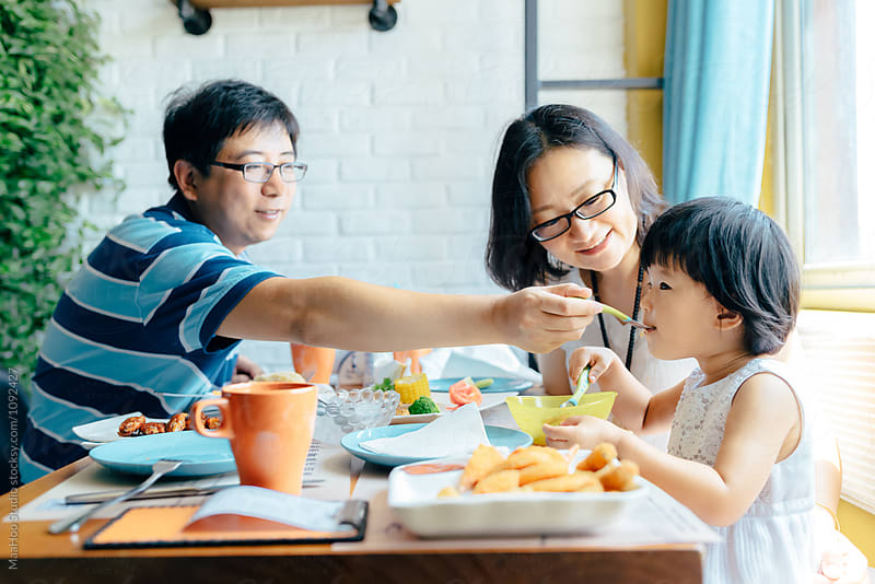 Chinese family at home by Maa Hoo for Stocksy United