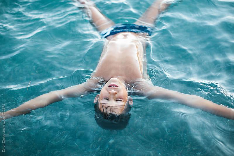 Boy enjoys the sea by Zocky for Stocksy United