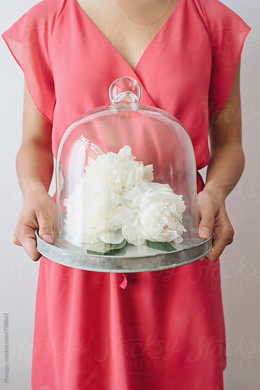 Peonies on tray with glass dome by Preappy for Stocksy United