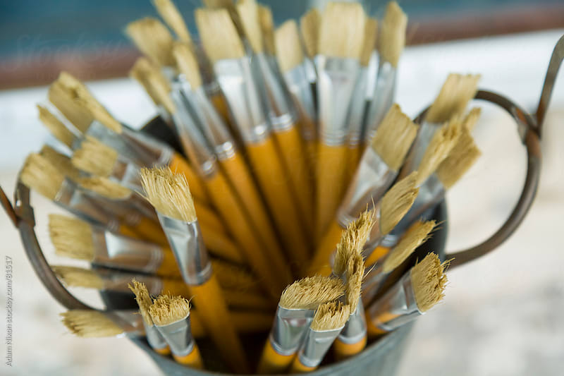 Paint Brushes in a Bucket by Adam Nixon for Stocksy United
