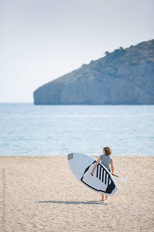 Woman doing sup by Blai Baules for Stocksy United