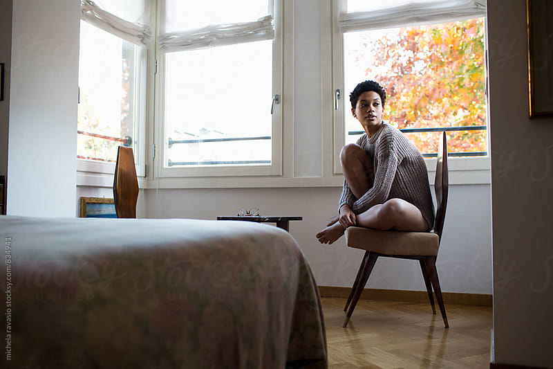 Black young woman relaxing at home by michela ravasio for Stocksy United