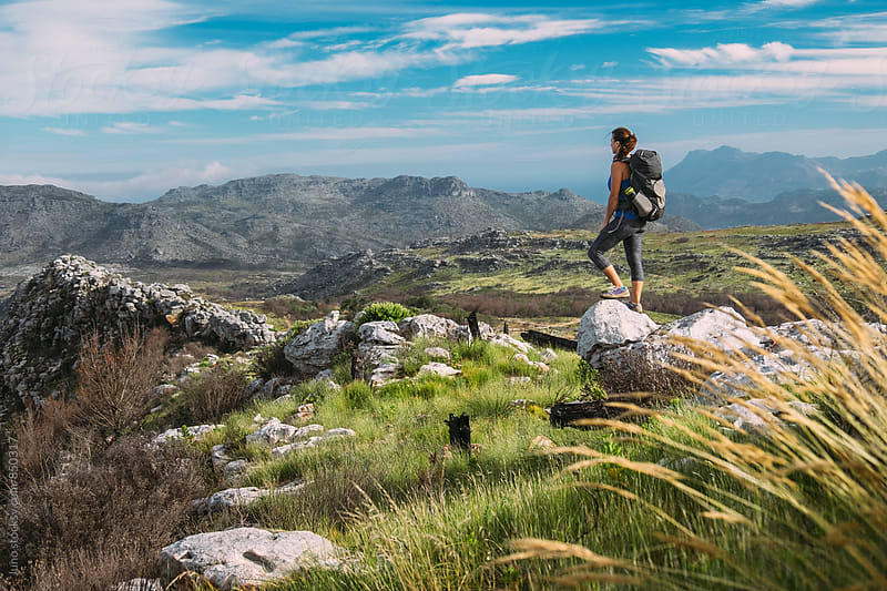 Female hiker with a backpack in the mountains in summer by Micky Wiswedel for Stocksy United