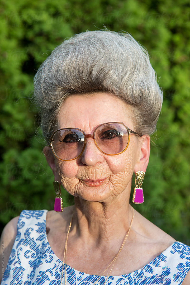 557bdbce2b Portrait of an over 70 years old woman wearing glasses looking at camera by  Beatrix Boros
