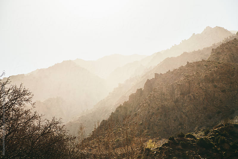 Hazy mountains in warm afternoon light. Ourika Valley, Atlas Mountains, Morocco. by Alejandro Moreno de Carlos for Stocksy United