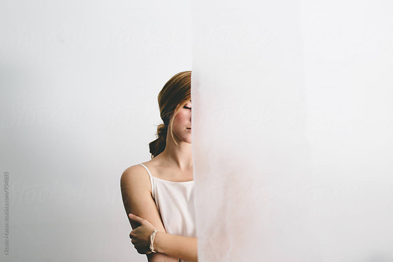 portrait of young woman with white background  by Nicole Mason for Stocksy United