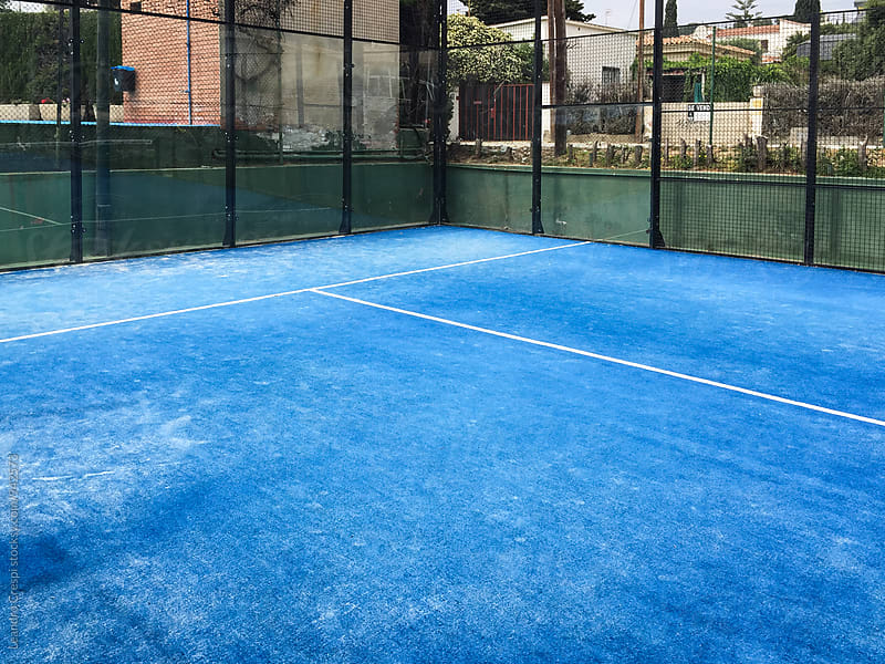 Empty paddle court, blue carpet. no players are visible by Leandro Crespi for Stocksy United