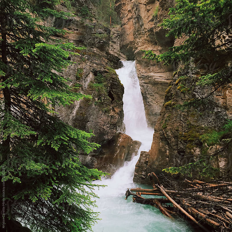 Waterfall in Johnston canyon, Banff national park, Canada by Kristen Curette Hines for Stocksy United