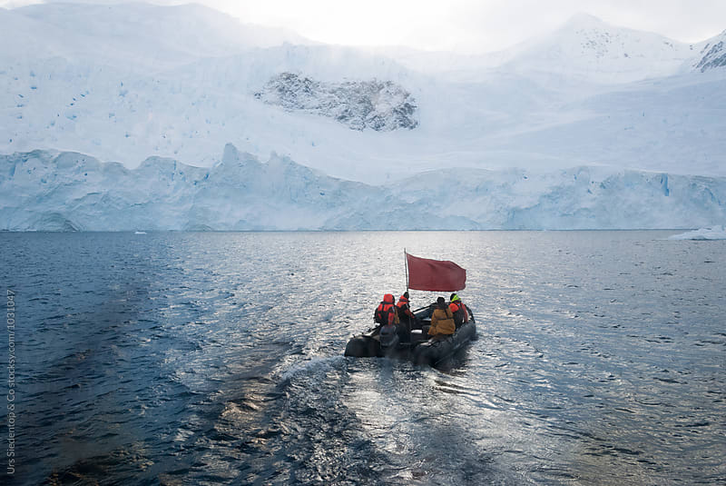 Antarctica exploration with rubber boat by Urs Siedentop & Co for Stocksy United