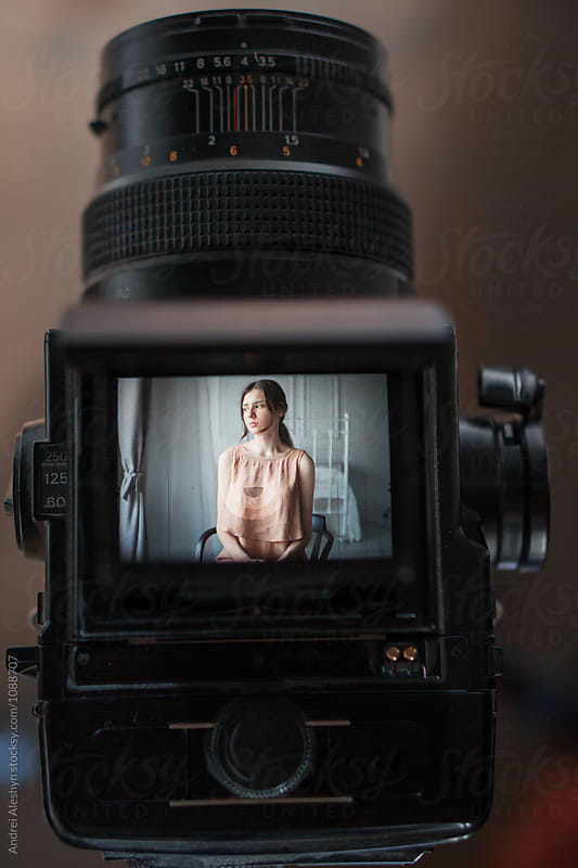 beautiful young girl posing for a vintage camera by Andrei Aleshyn for Stocksy United