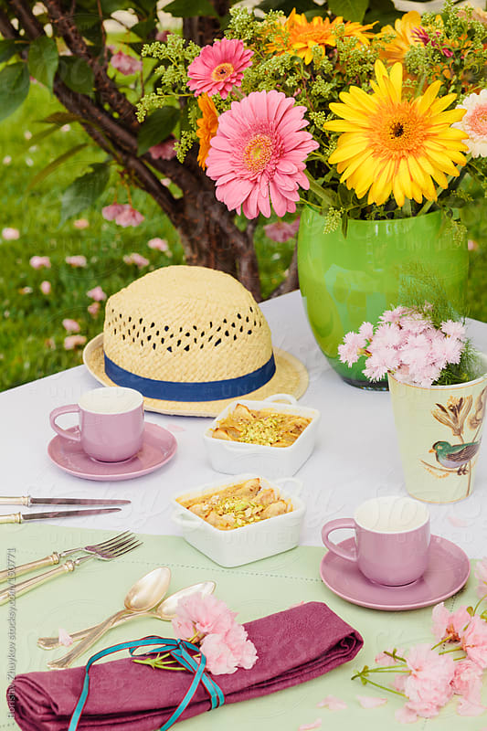 Beautiful spring decorated table with apple pies  by Borislav Zhuykov for Stocksy United