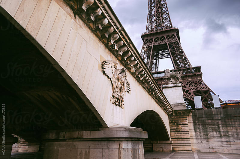 Eiffel Tower from below a bridge by ACALU Studio for Stocksy United