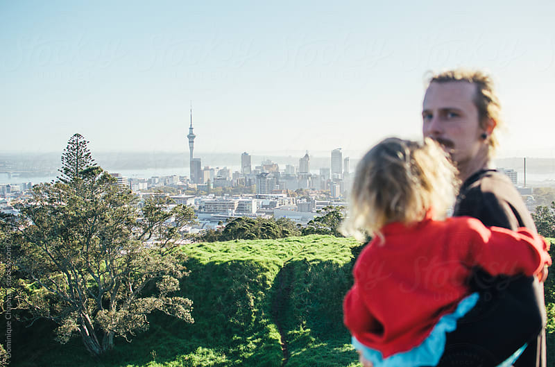 Father and daughter looking out at Auckland by Dominique Chapman for Stocksy United