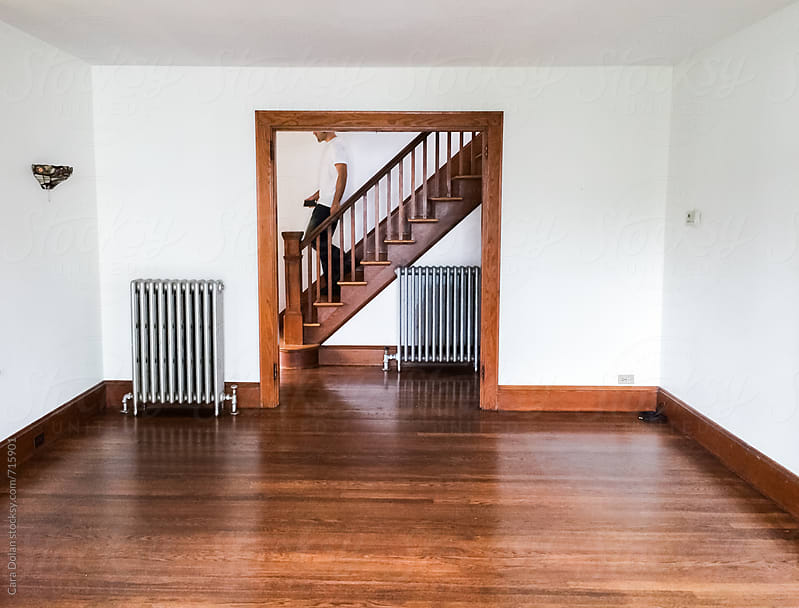 Man walks through his empty home by Cara Slifka for Stocksy United