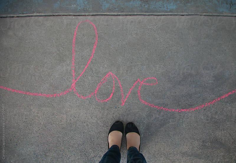 Female's feet with love written in cursive using chalk by Carolyn Lagattuta for Stocksy United