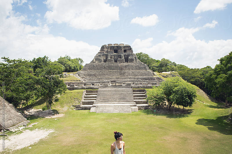 Woman Standing in Front of Ancient Mayan Temple by MEGHAN PINSONNEAULT for Stocksy United