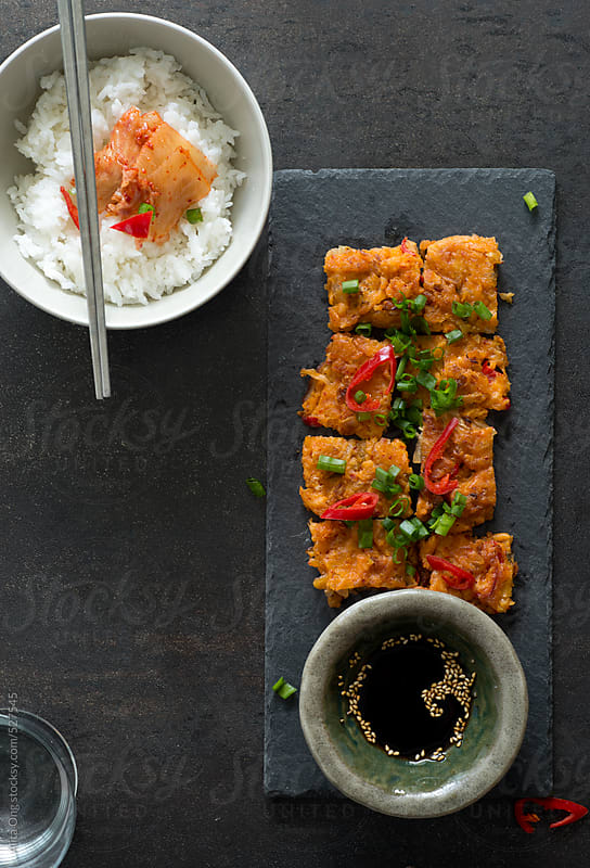 Kimchi pancakes - overhead view by Alita Ong for Stocksy United
