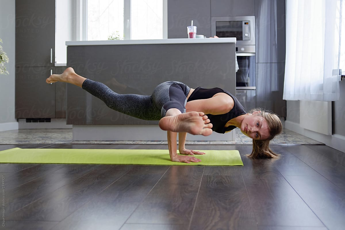 Woman Doing Advanced Yoga Pose By Clique Images Stocksy United