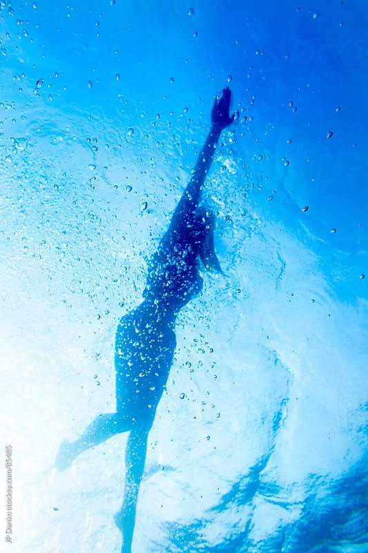 Sexy Woman in Bikini Silhouette Swimming Underwater by JP Danko for Stocksy United