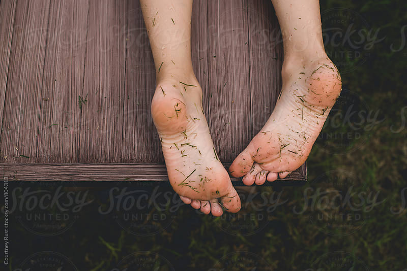 dirty grass feet by Courtney Rust for Stocksy United