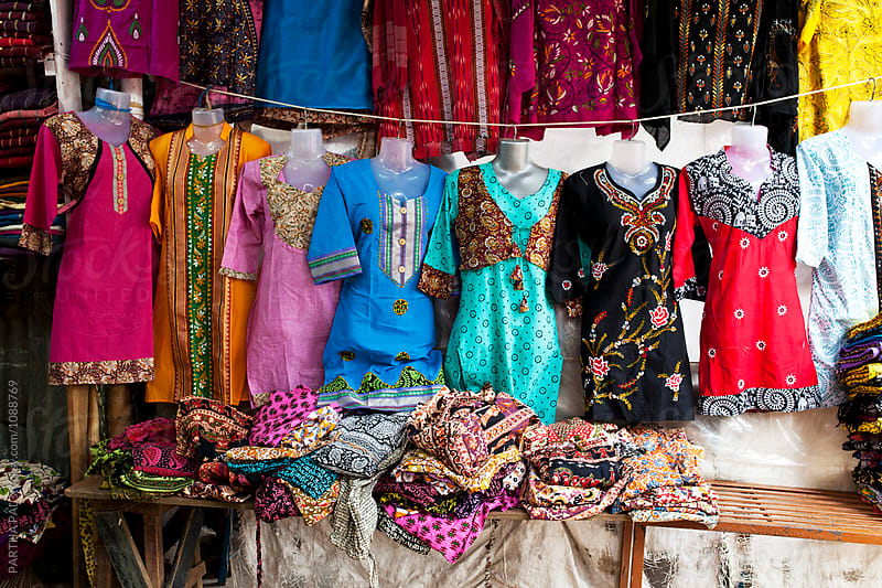 Indian dress materials selling in a local market by PARTHA PAL for Stocksy United
