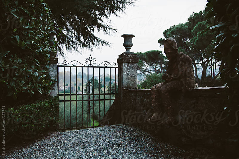 gate at the top of a hill at a villa in lucca, italy by Sarah Lalone for Stocksy United