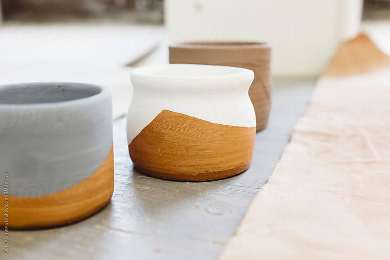 Ceramic mugs with glaze designs by Carey Shaw for Stocksy United