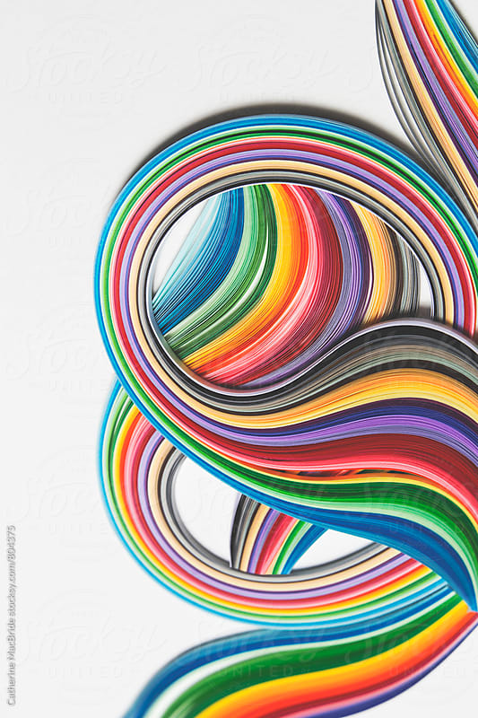 Curves of colourful paper strips... by Catherine MacBride for Stocksy United