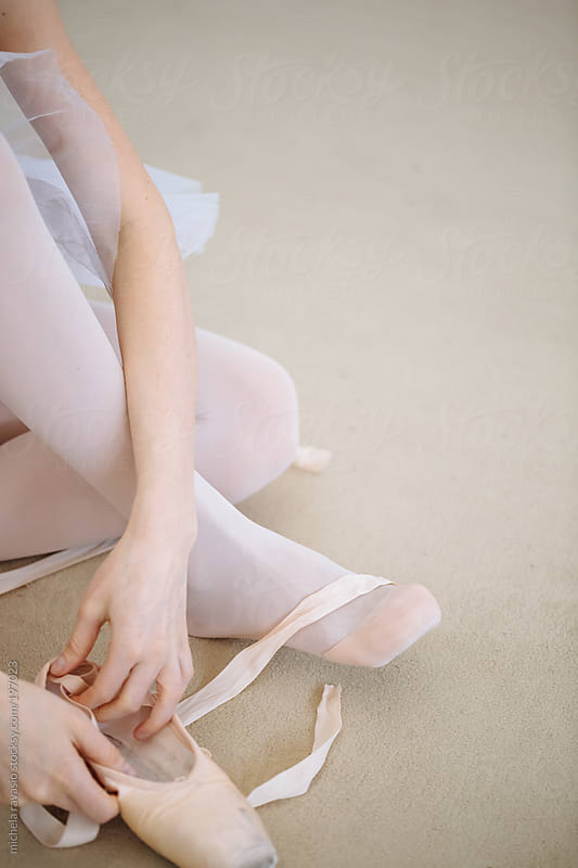Classical dancer puts on pointe shoes by michela ravasio for Stocksy United