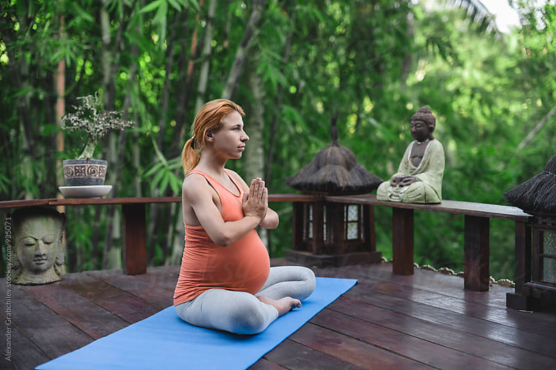Pregnant Yoga Meditation by Alexander Grabchilev for Stocksy United