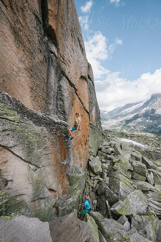 two female rock climber in high alpine terrain by Leander Nardin for Stocksy United