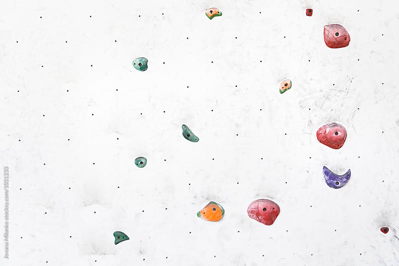 Colorful indoor artificial free climbing wall by Jovana Milanko for Stocksy United