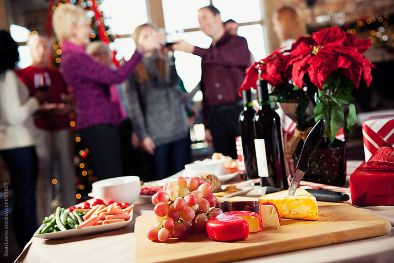 Christmas: Table Full of Party Snacks by Sean Locke for Stocksy United