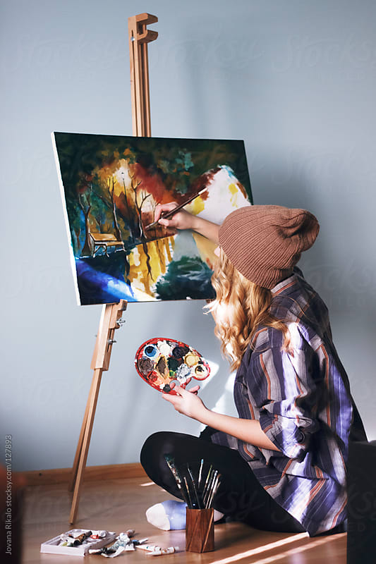 Girl painting by Jovana Rikalo for Stocksy United