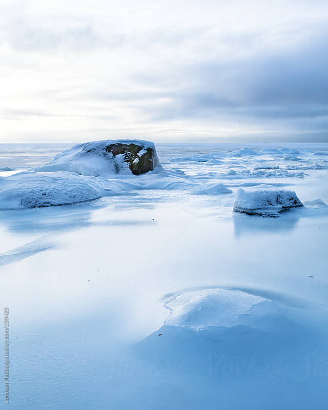 The frozen sea outside of Helsinki on a cold winter day by Jonatan Hedberg for Stocksy United