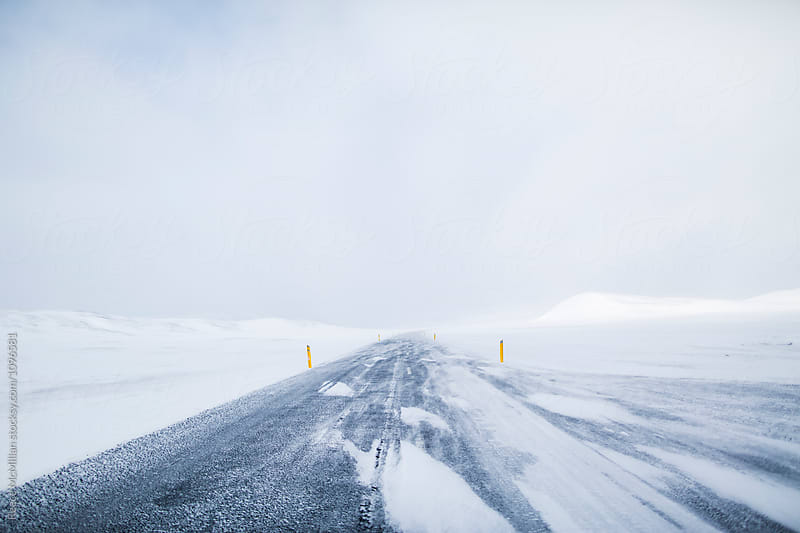 A long straight road through Iceland in Winter by Reece McMillan for Stocksy United