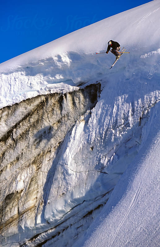Skier jump off glacier wall in Greenland by Soren Egeberg for Stocksy United