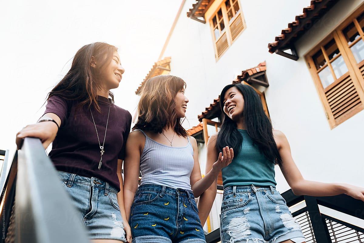 Asian Friends Women Having Fun In The Street. by Santi Nuñez