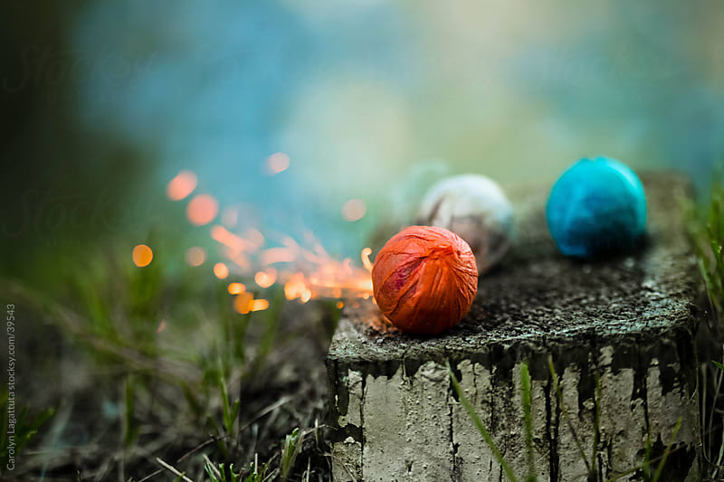 Colorful smoke bombs and sparks by Carolyn Lagattuta for Stocksy United