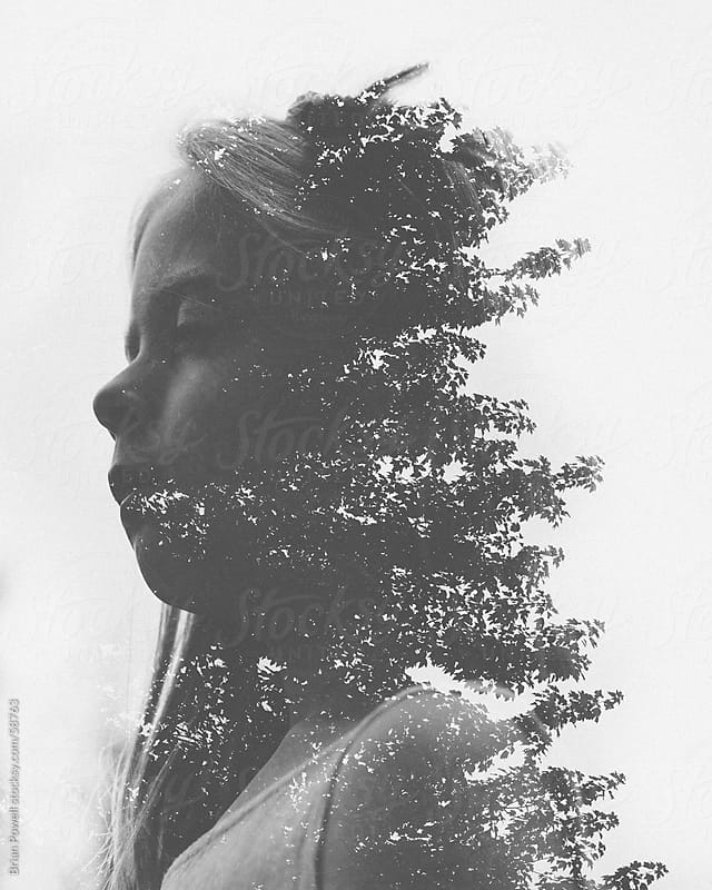 double exposure of girl and tree by Brian Powell for Stocksy United