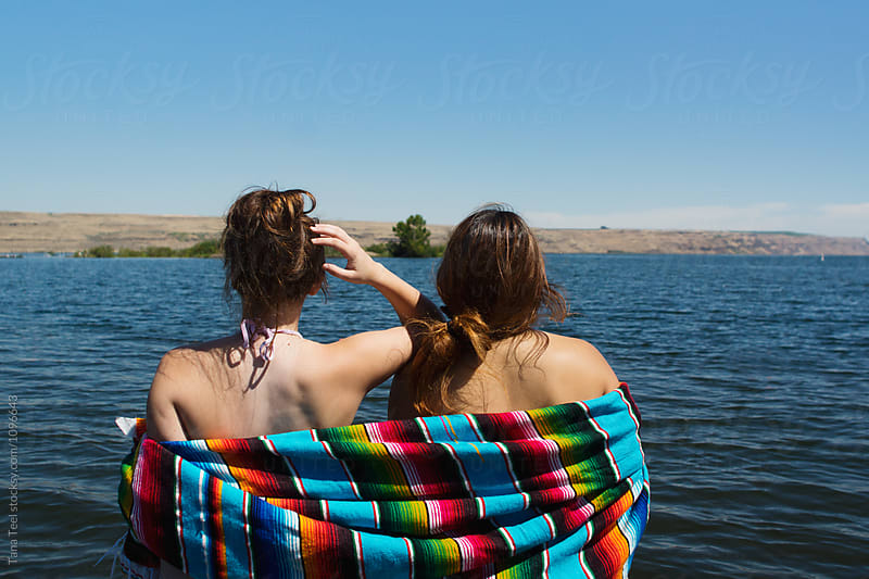teenagers at river wrapped in serape blanket by Tana Teel for Stocksy United