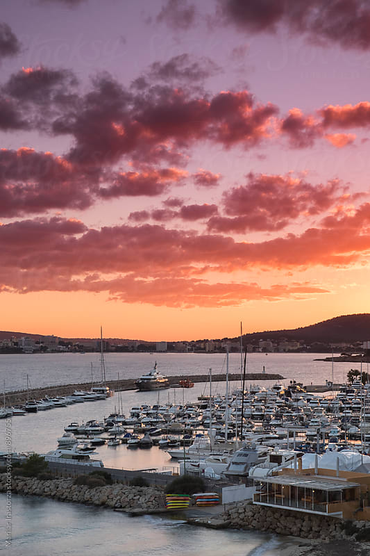 Vibrant sunset over a marina by Marilar Irastorza for Stocksy United